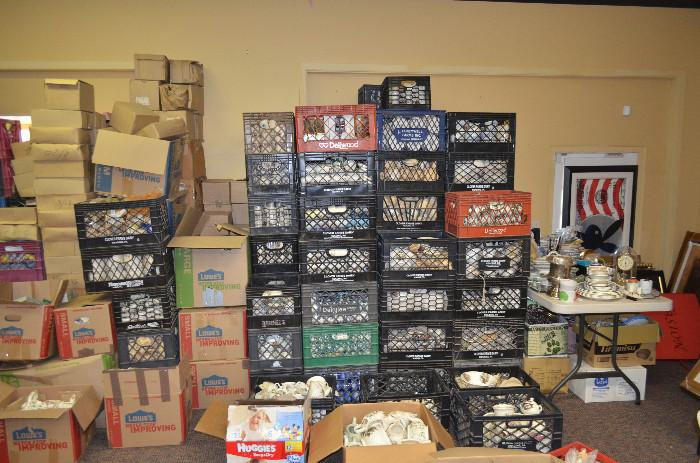 Just one side of our showroom packed to the brim with crates and boxes, seven high and three deep! These have not been unpacked or picked through in any way. You can be the first to look through them and find a rare or desirable piece for your gallery or collection.