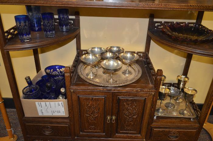 Cut cobalt glass and silverplate. Chinese shelving unit not for sale.