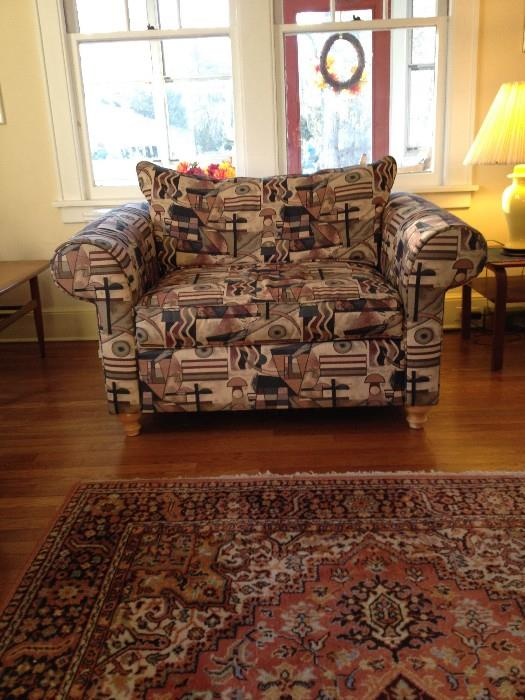 Chair and a half sofa.  A comfortable way to see with someone you want to be close to.  Very soft and comfortable cushions.