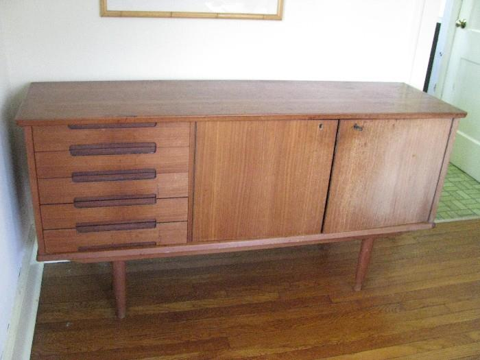 Wooden cabinet.  Good for holding china and silverware.