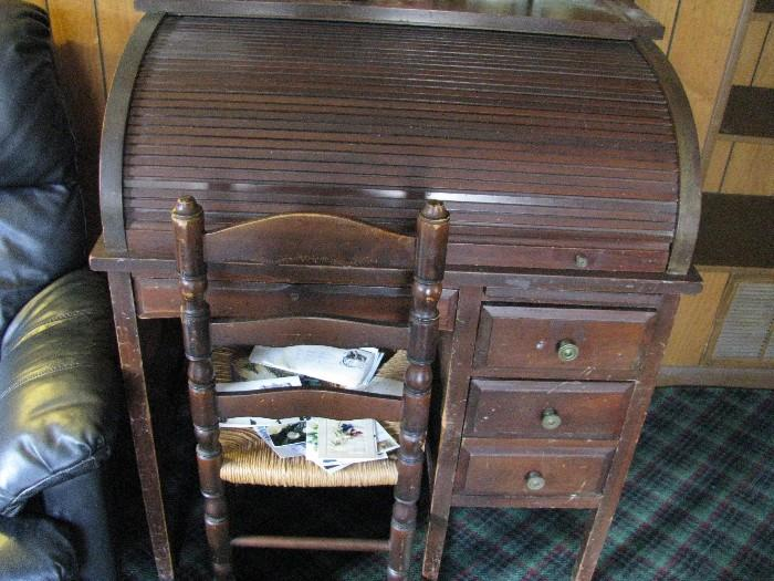 Closer view of rollup wooden antique desk.