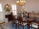 Ethan Allen Cherry dining table, 6 chairs, 2 leaves and table pads
