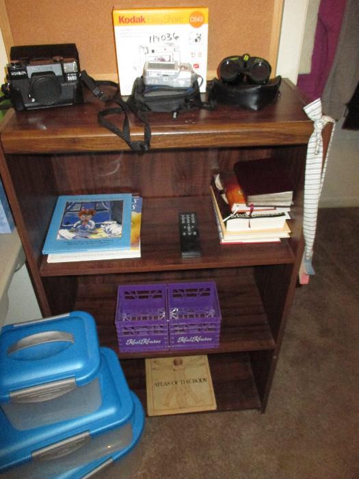 Minolta and Kodak Cameras, Bushnell Binoculars, Several Sweet Children Books, Sterilite Like New Containers