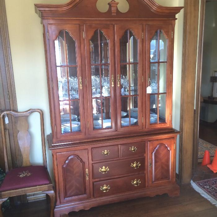 Lovely Drexel china cabinet with Waterford crystal; one of 3 matching needlepoint chairs (to left)