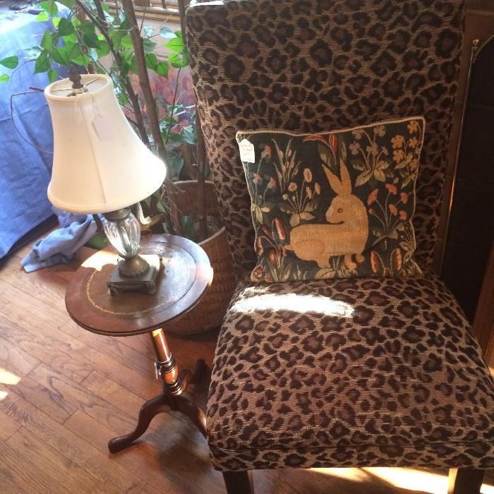 Leopard print chair; 1 of many decorative pillows; small side table & lamp