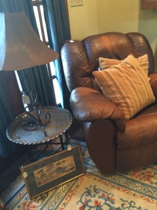 Leather recliner; small side table; 1 of the many lamps
