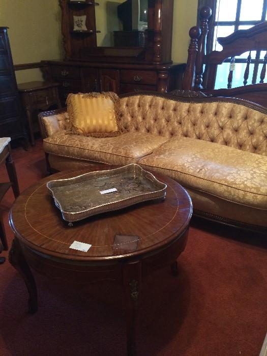 Another gold antique sofa; round table; king bed & matching dresser (in back)