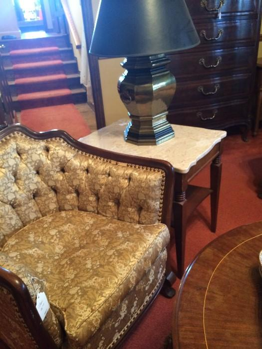 Antique gold chair; 1 of 2 marble top side tables; 1 of 2 brass lamps