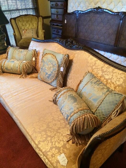One of 2 antique sofas; lovely blue & gold pillows (has matching comforter); Henredon king headboard (behind sofa); antique chair  & 2 nightstands (back left);