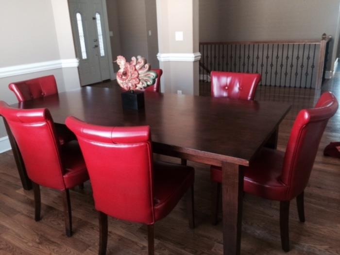 nice dining table with red pleather chairs