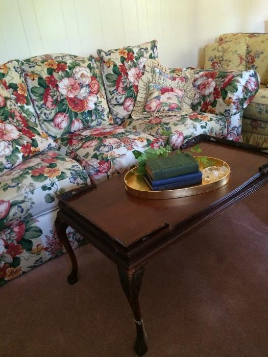 Coffee table, gold oval tray, & floral sofa