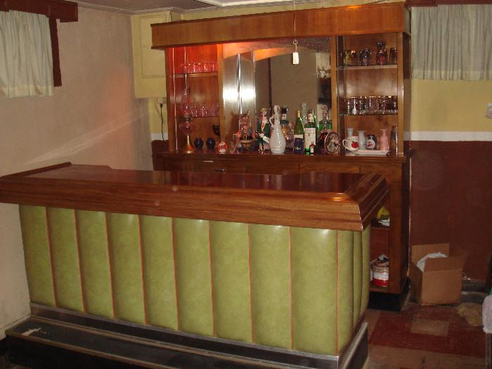 Seven 7 foot bar and bar-back.