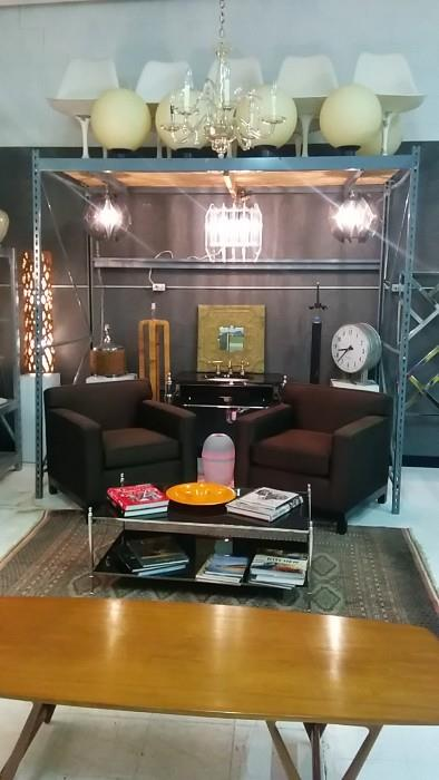 Saarinen Tulip Chairs, pair acrylic pendant lights, good acrylic chandelier, pair of crappy chairs, but the frames are great - competent upholsterer please apply! Kohler black/chrome sink, cool, wall-mounted industrial clock, chrome/black glass two-level coffee table, hand woven Bokhara rug, Arne Vodder coffee table.