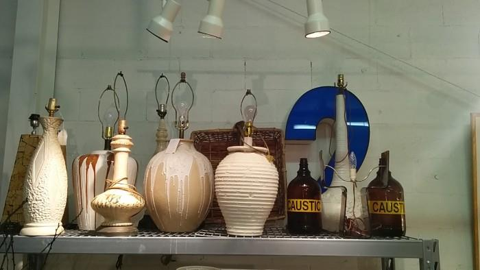 "Lamps from a frosting factory in Denmark. The big, while phallic lamp on the right is joined by two bottles of caustic goop. Just in time for the opening of ""Fifty Shades of Grey"". What's up with #2?"