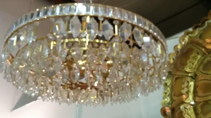 Not a great pic, but this is an English MCM crystal chandelier, that looks as if it's gold plated. Squint.