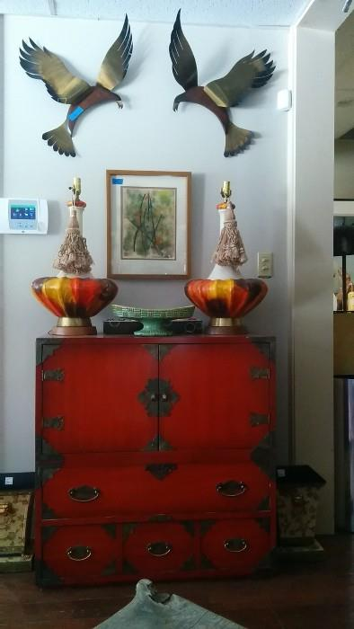 "Very nice Asian Chest, with pair of wonderfully color-coordinated lamps, pair of tole planters, original framed artwork, circled by two hungry seagulls. Their parents starred in the 1963 Hitchcock thriller, ""The Birds""."