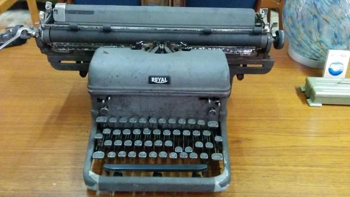 Ta da! Lovely Royal typewriter has been banged around a while, but if you were on the set of Mad Men, you'd get banged too.