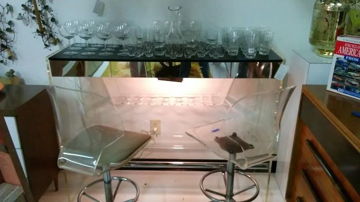 Acrylic bar, with pair of acrylic barstools and assorted time capsule barware.