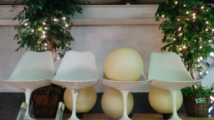 4 plastic spheres of love, 4 Saarinen chairs, ret to go for restoration (too many projects) flanked by a pair of aura-recharging silk ficus trees, with twinkling white lights.