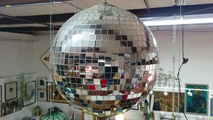 What warehouse sale is complete without a functioning disco ball? Guess the provenance and you get a free bottle of poppers!