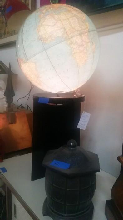 One of two illuminated globes, from the 1960's, on stands.