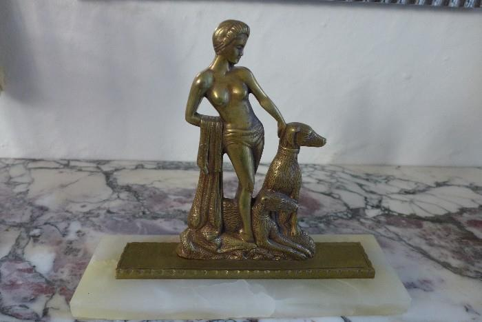 Art Deco patinated bronze sculpture mounted on white marble plinth