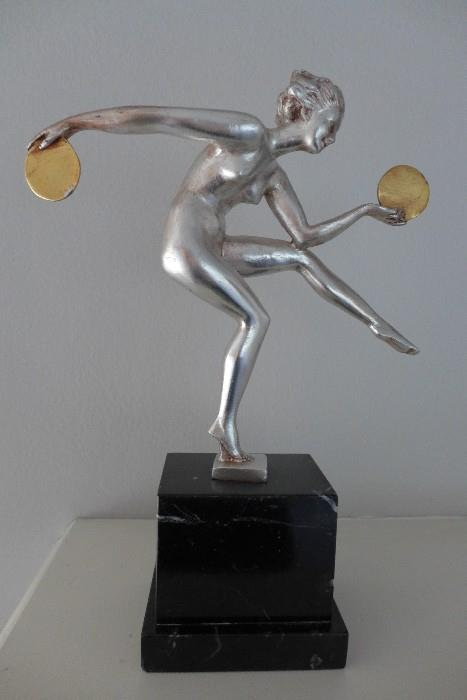 Art Deco metal sculpture depicting dancing female nude mounted on marble plinth