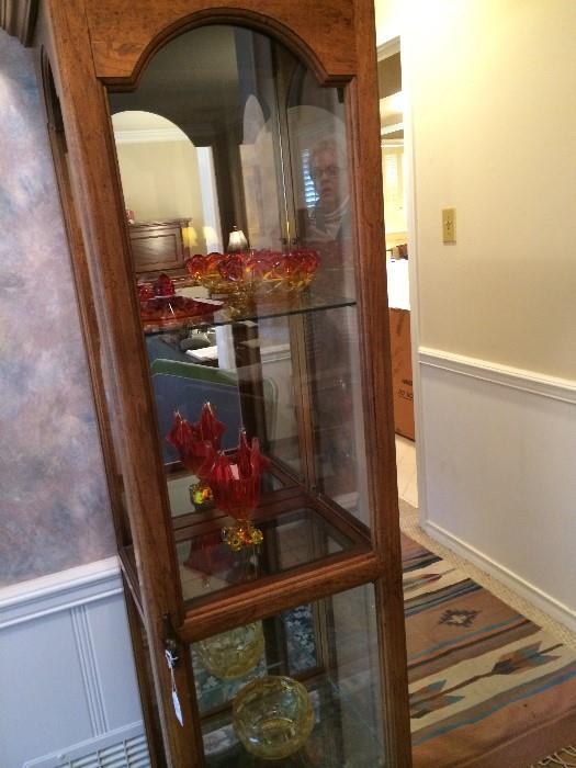 Curio cabinet; colored decorative glassware/bowls