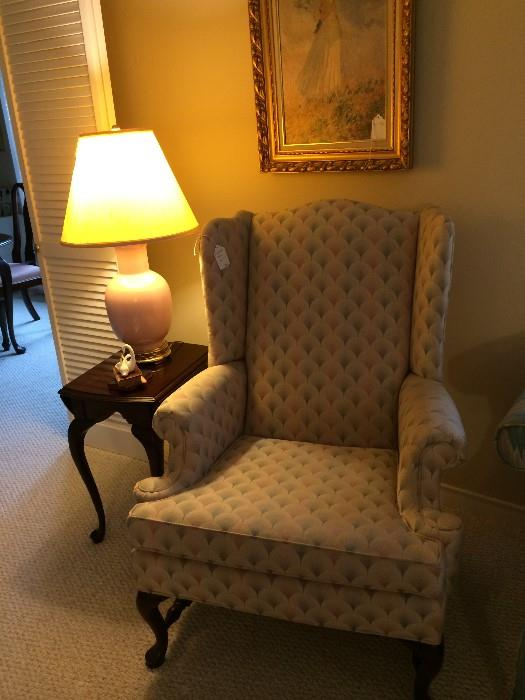 One of two matching wing-back chairs