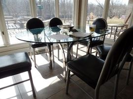 Glass & iron table with 6 leather chairs