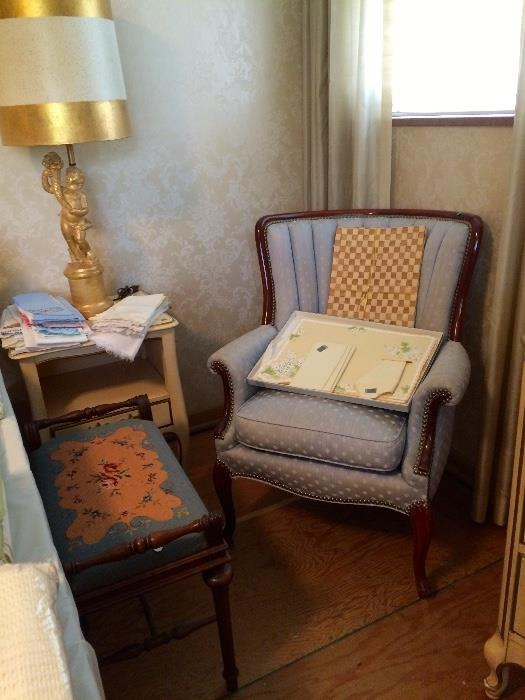 Needlepoint Ottoman, Cherub Figural Lamps and Mahogany Blue Upholstered Arm Chair