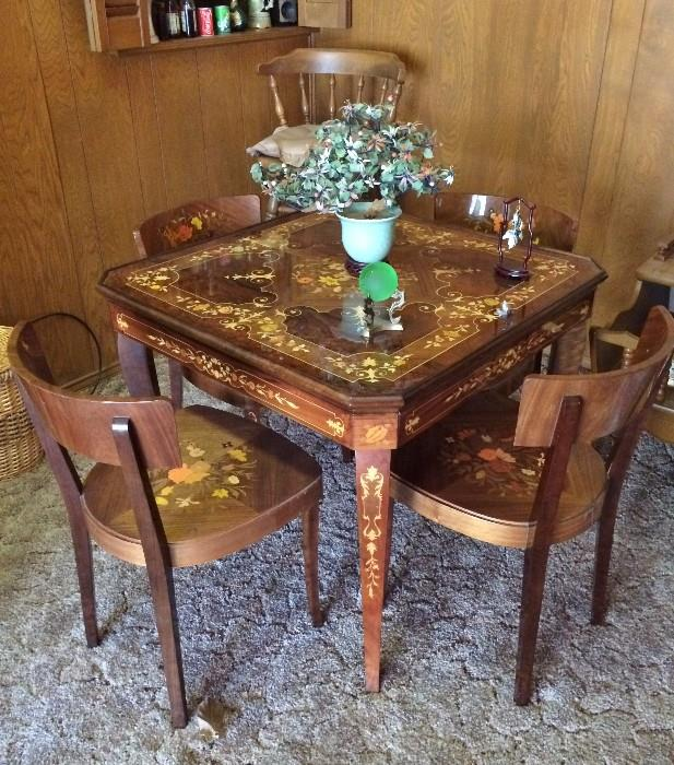 Very Nice (ornate) game table with 4 chairs  (Felt on other side of top, reverses to play games)