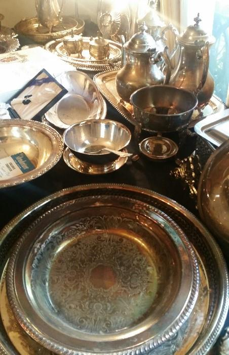 Tables full of Silver Plate (Tea Pots, Trays, etc...)