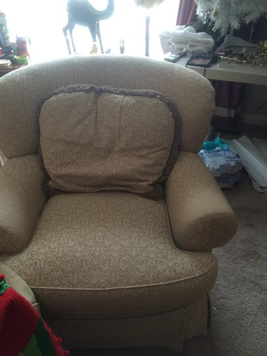 two chairs and an ottoman