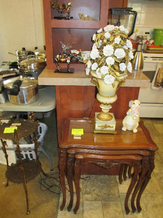 This sale is absolutely Fabulous.  On top of the beautiful wood nesting tables is what I believe to be a Vintage Italian Tole Style Lamp. Another lovely piece is a two tiered metal table or plant stand.