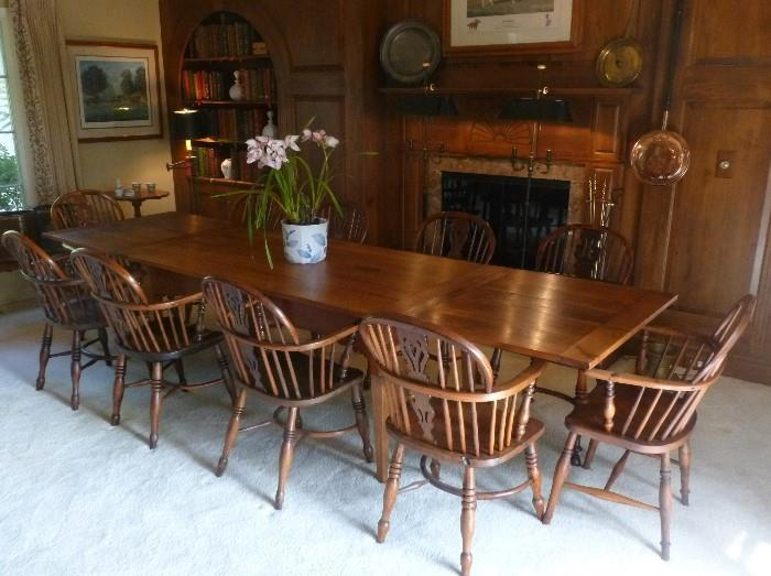 Country French cherry wood draw leaf table with an assembled set 10 of English yew wood Windsor chairs.