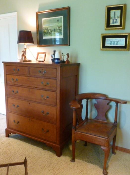 18th century mahogany chest of drawers and a robust corner chair.