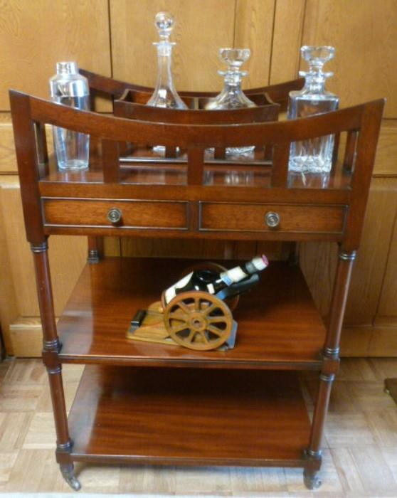 Edwardian liquor stand in mahogany.  Crystal decanters.
