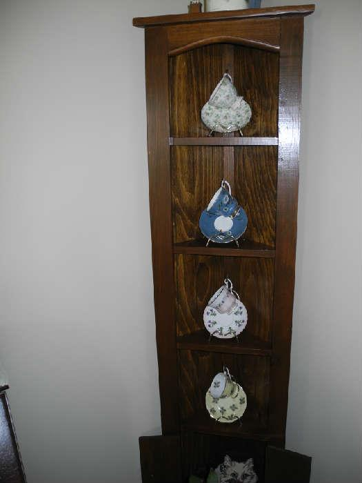 Cute corner display cabinet with cup/saucer collection