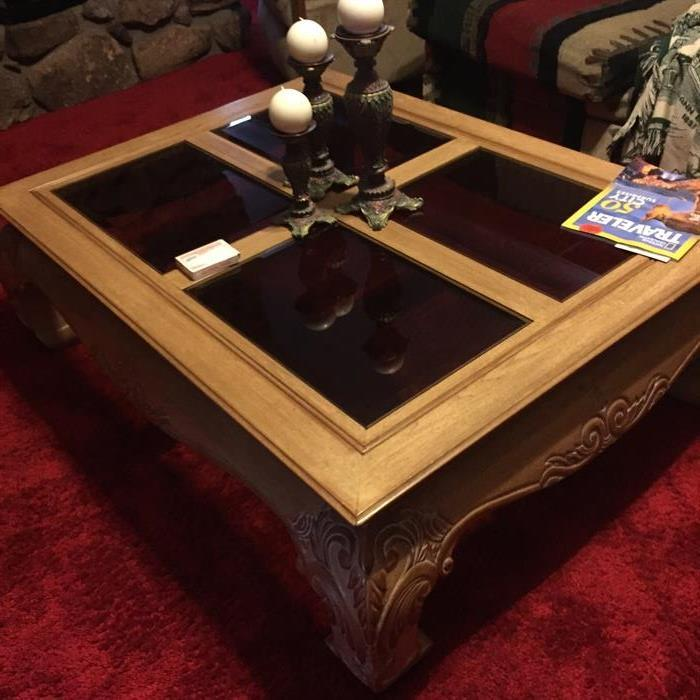 Large glass and wood coffee table.