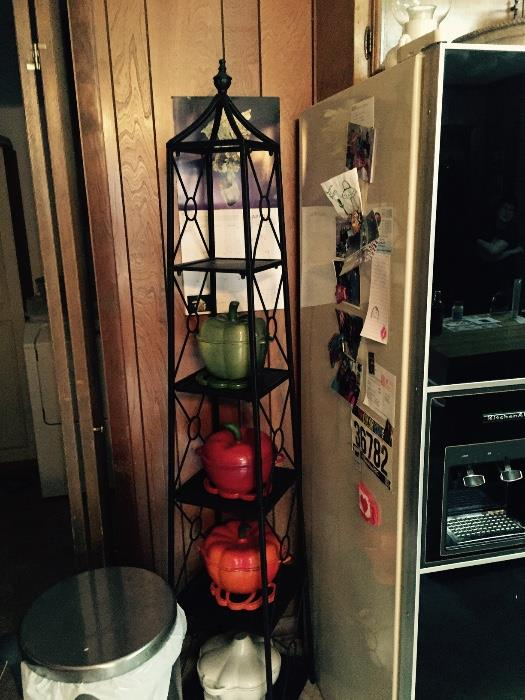 Wrought iron shelf with cast iron and enamel servers.