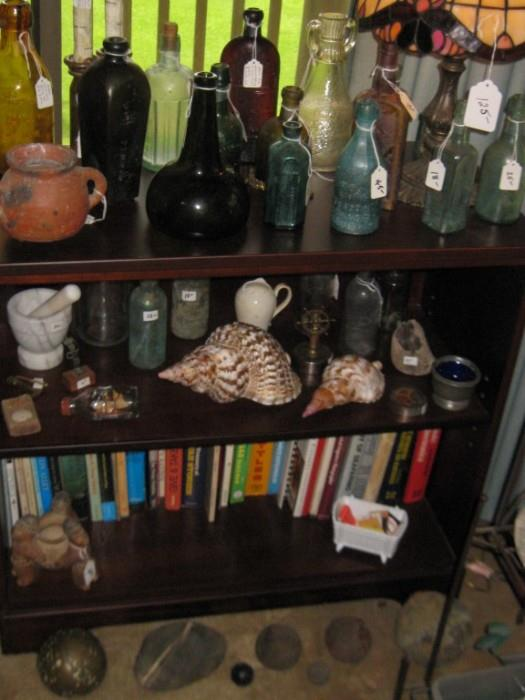 BOTTLES, SHELLS, & BOOKS