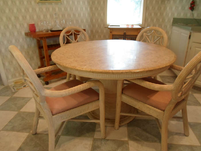 kitchen dining set w/4 chairs (has a little damage but would be good for rental or under a covered patio or arkansas room
