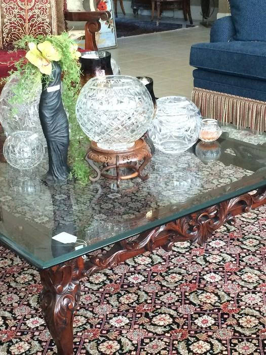 Glass top coffee table & some of the many rose bowls