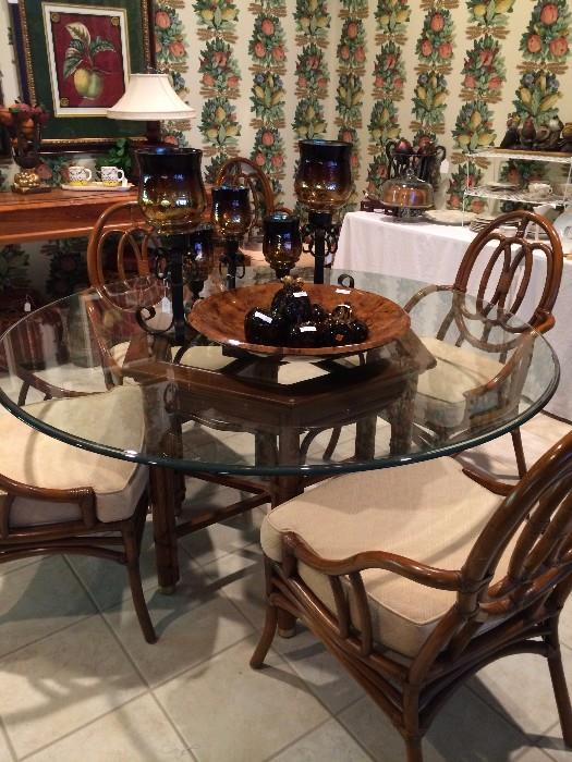 Glass top breakfast table and 6 chairs with cushioned seats; decorative accents