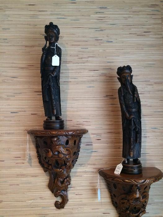 Asian figures on carved wall shelves