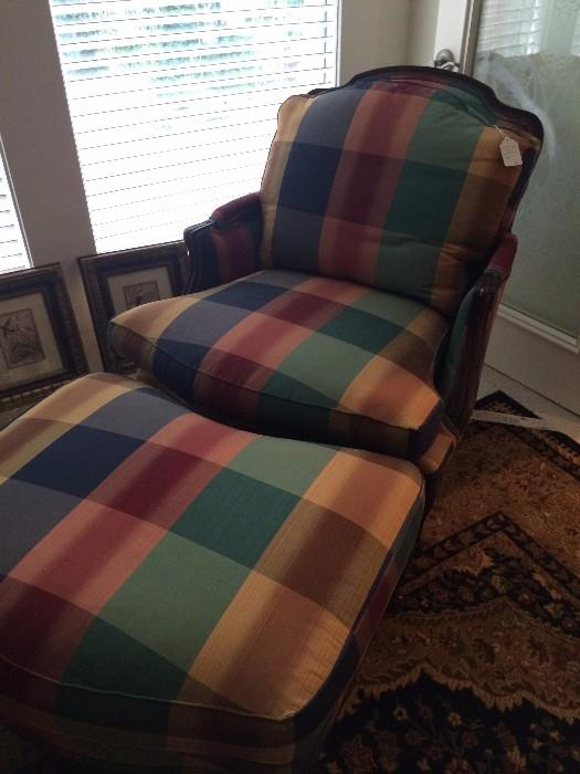 One of two checked upholstered chair with ottoman