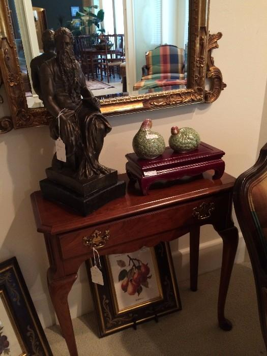 Small side table with 1 drawer; statue, decorative birds, mirror, and fruit print