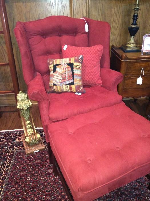 Red & comfortable wing-back chair with ottoman