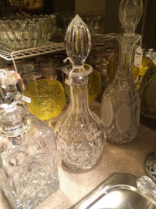 Several pressed glass decanters